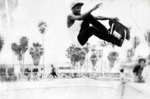 skater doing a air grab in venice beach california
