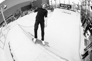 Curren Caples on the coping watching the camera