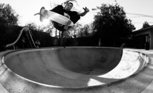 Greyson Fletcher doing a frontside air in a pool with a cruiser deck