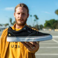 Jon Dickson showing his emerica Pro-model Shoes